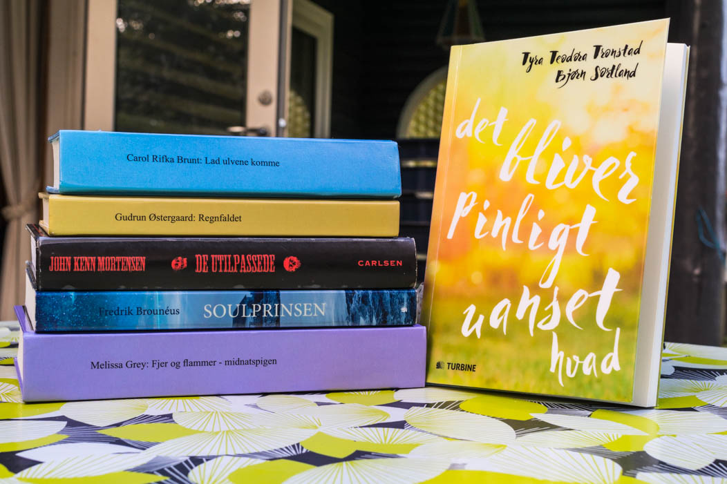 My summer reads on a table here amongst are Tell the Wolves I'm home, The Girl at Midnight and the Prince of Soul and The Lighthouse.