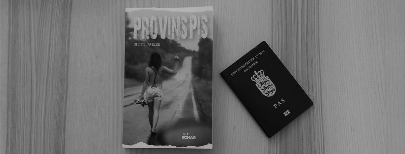 The book Provinspis on a table next to a passport.
