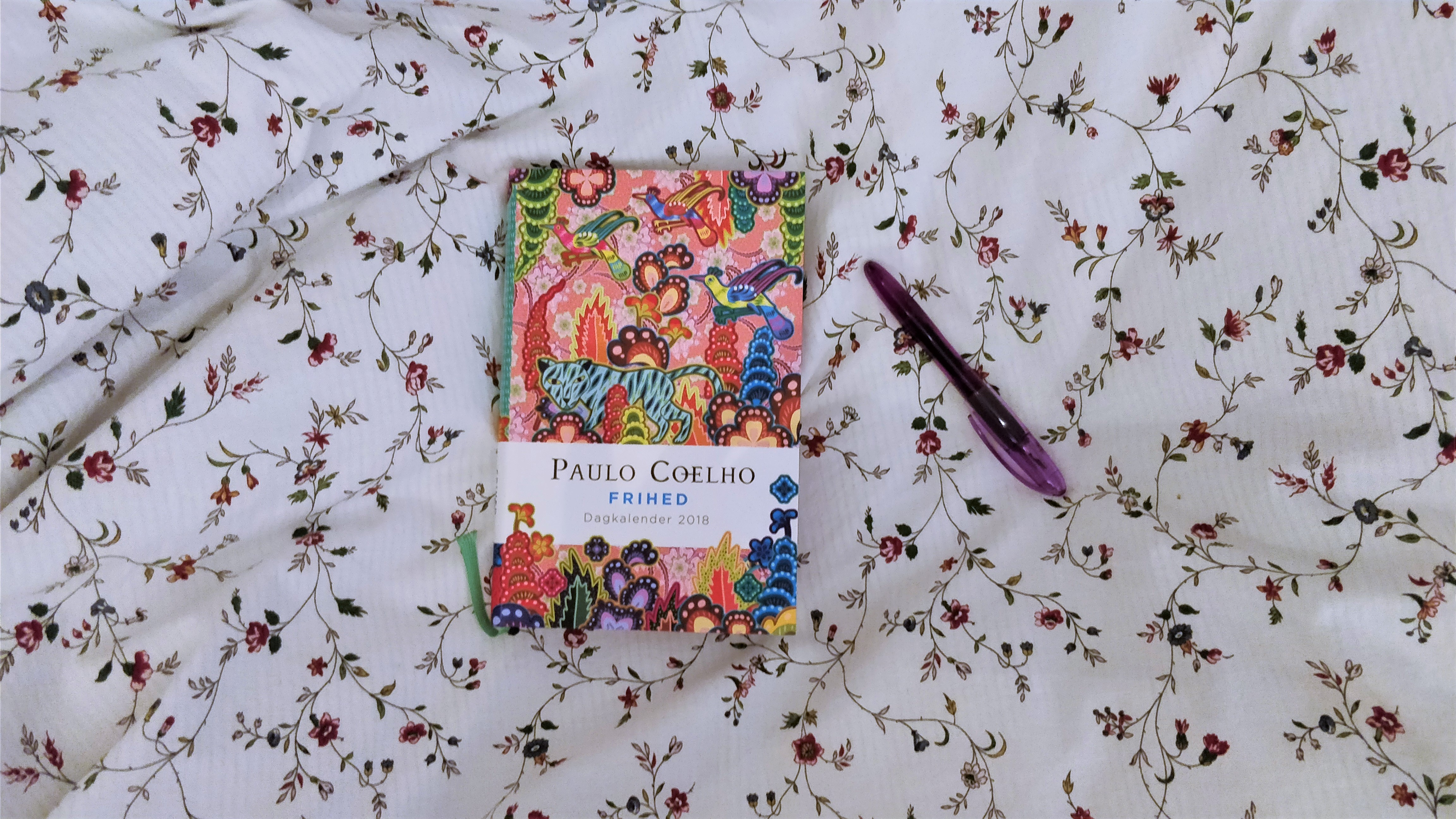 My book journal and a fountain pen on a flowery background