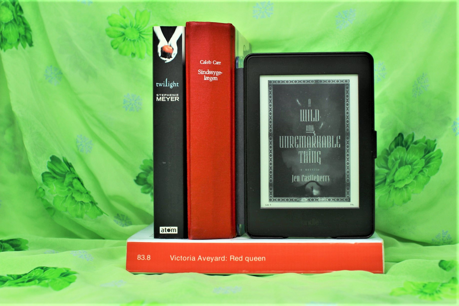 Four books, here amongst A WIld and Unremarkable Thing, on a green background.