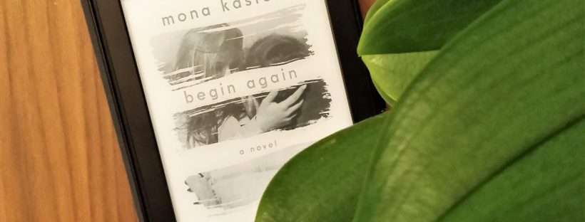 Begin Again by Mona Kasten on a wooden table next to a flower
