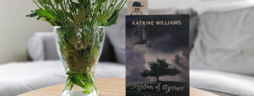 Bogen Monsun af stjerner på et bord ved siden af en buket af gule blomster.